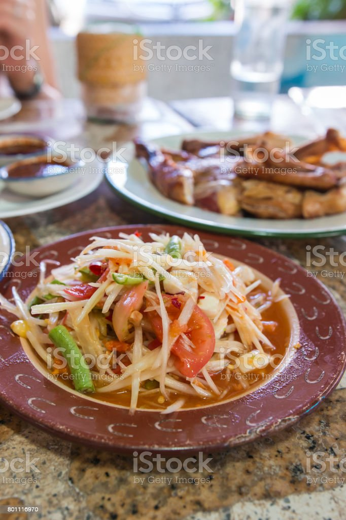 spicy papaya salad stock photo