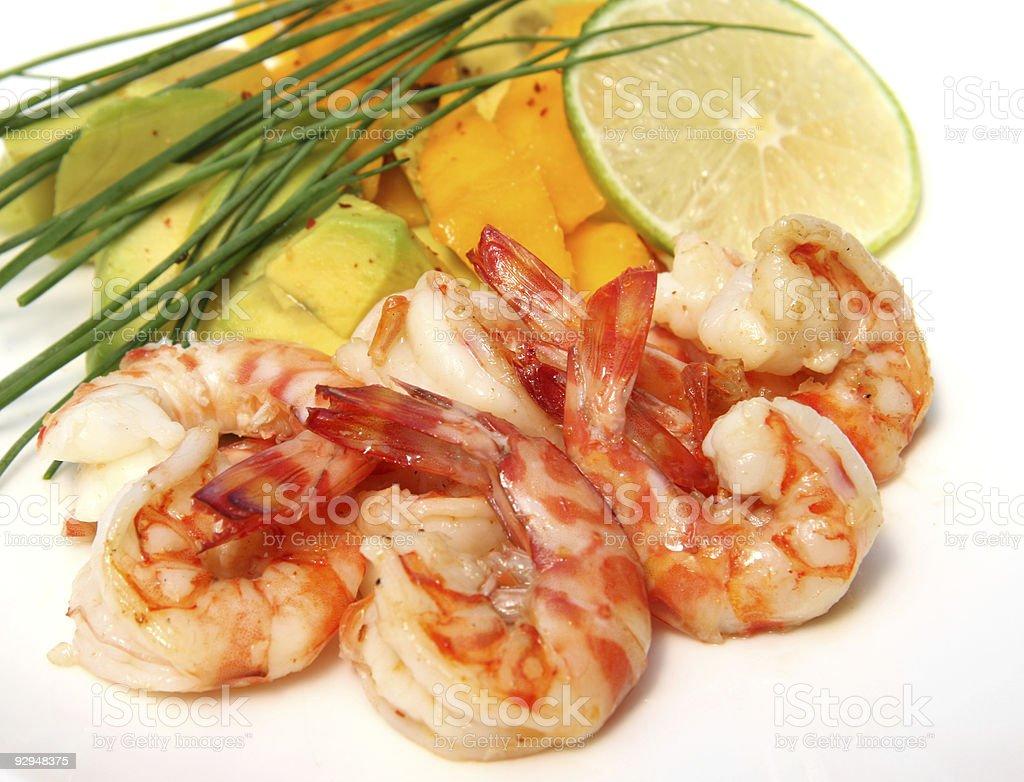 Spicy prawns with mango and avocado salad royalty-free stock photo