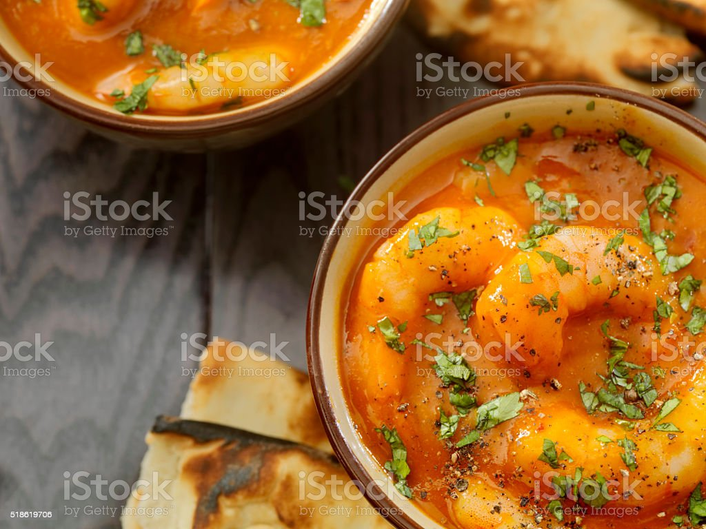 Spicy Red Curry Soup with Shrimp and Naan Bread stock photo