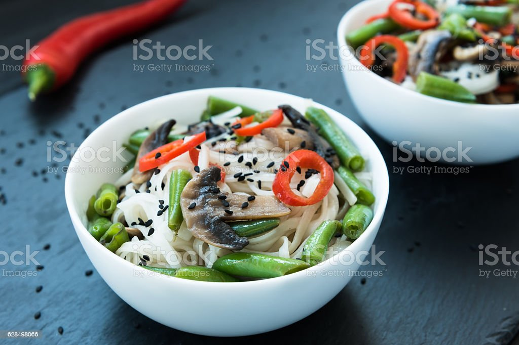 Spicy roasted teriyaki mushrooms and asparagus soba noodles stock photo