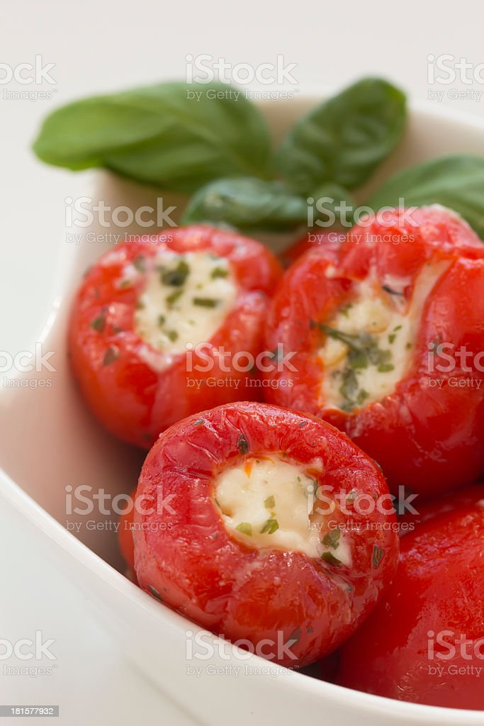 Spicy round red peppers stuffed with cheese royalty-free stock photo