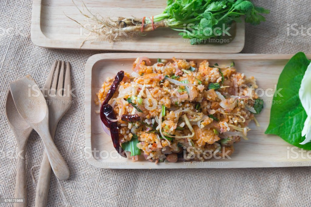 Spicy salad of curried rice croquettes on wooden tray stock photo