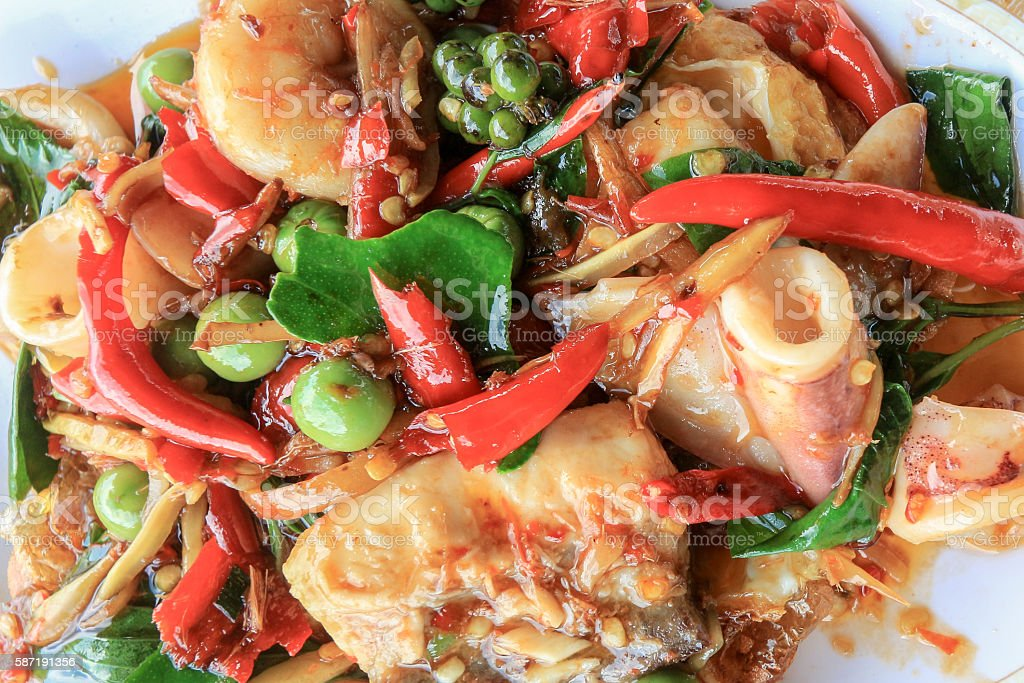 Spicy seafood stir fried, Thai spicy herb food stock photo