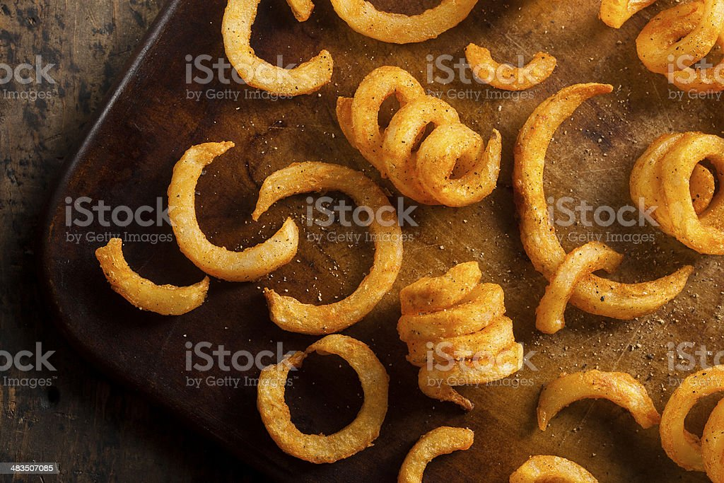 Spicy Seasoned Curly Fries stock photo