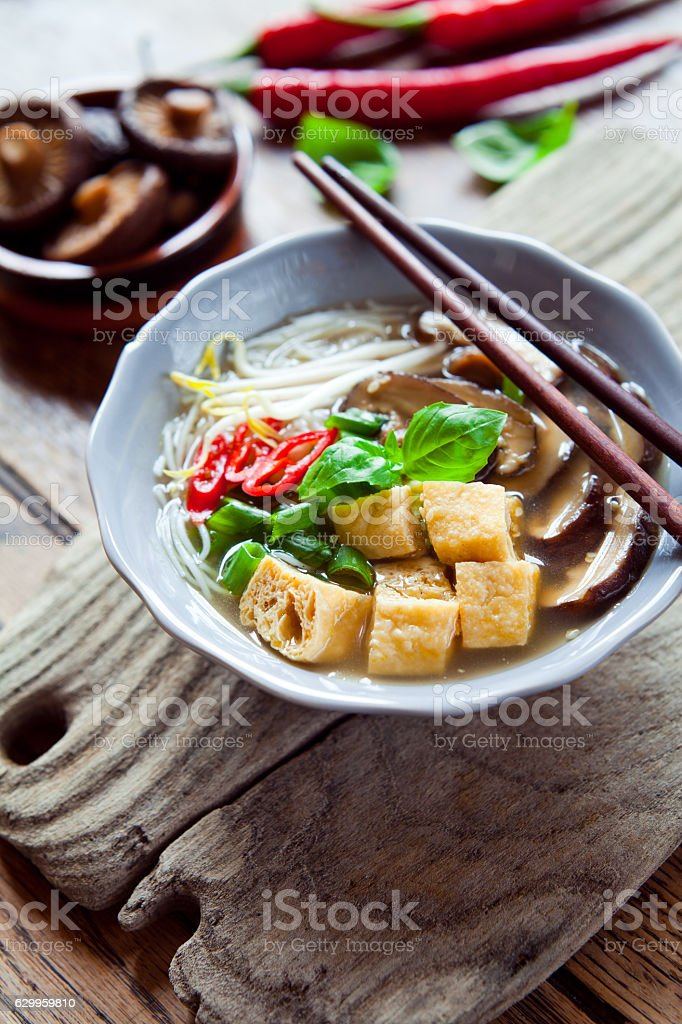 Spicy shiitake mushrooms , spring onions and fried tofu asian soup. stock photo