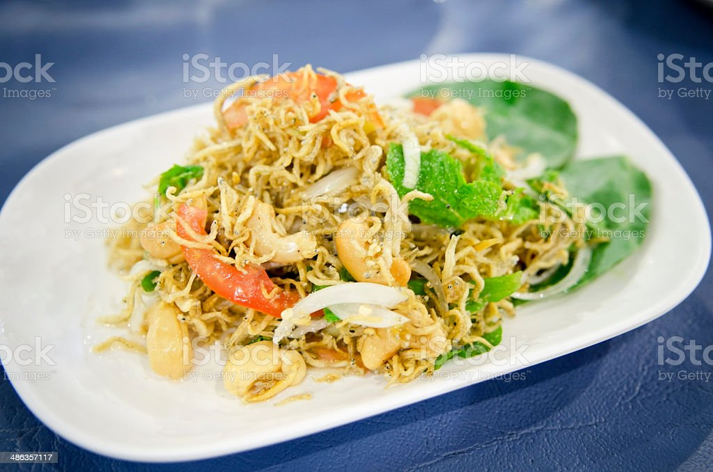 spicy small fish salad , mixed vegetable and herb stock photo
