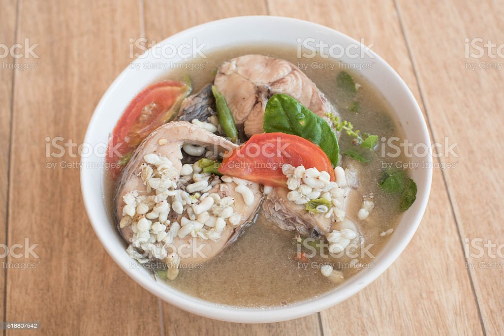 Spicy snakehead fish soup with ant eggs stock photo
