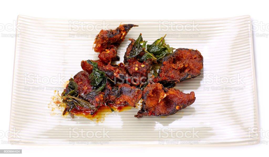 Spicy Stir Fried catfish on dish stock photo