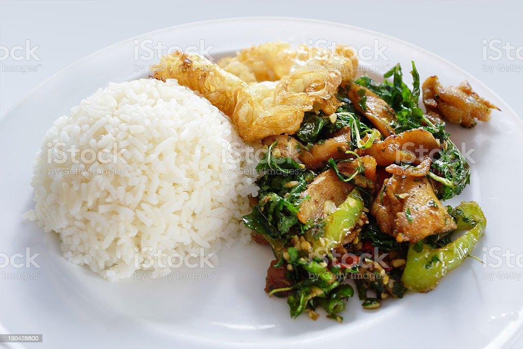 spicy stir fried chicken on rice stock photo
