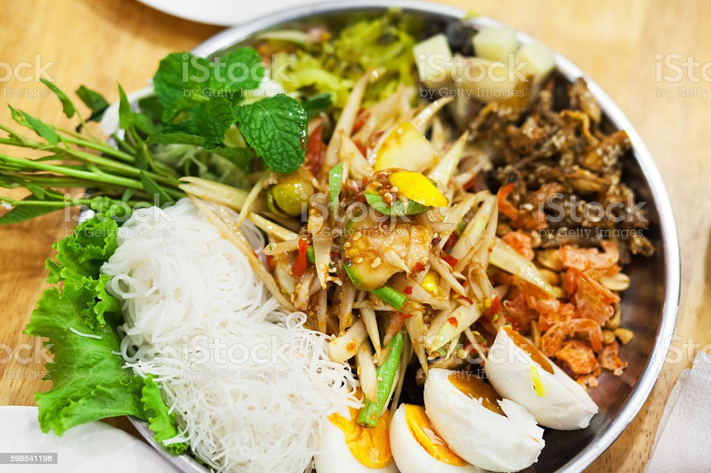 Spicy thai salad Som Tum with eggs stock photo