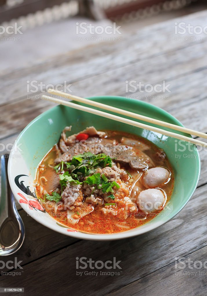 Spicy TOM YAM pork noodle soup stock photo