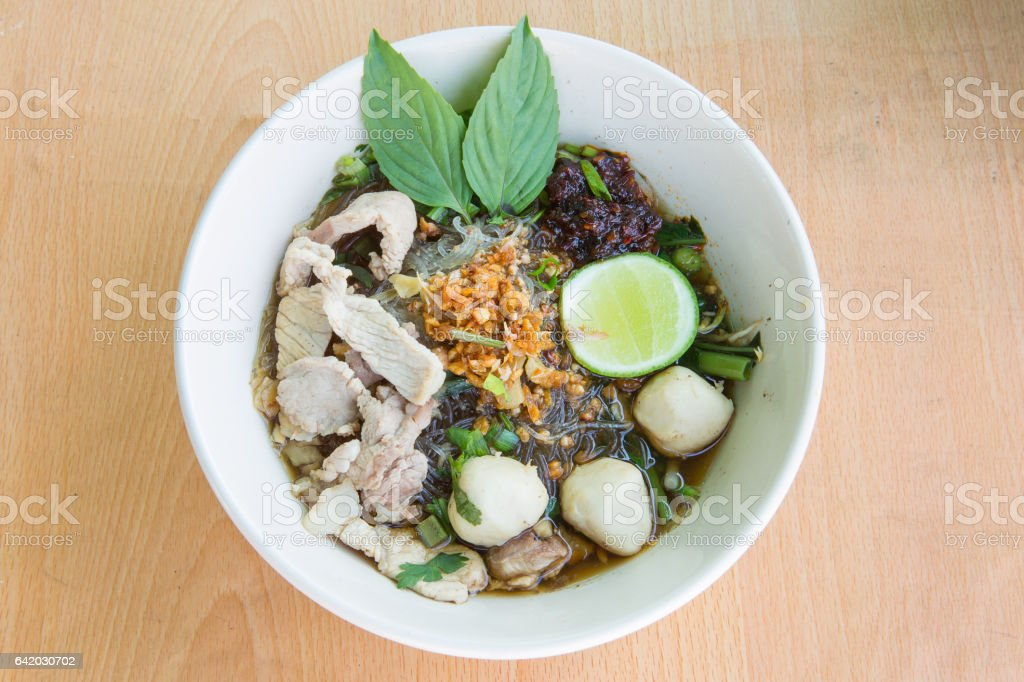 Spicy TOM YAM pork noodle soup with lemon. stock photo
