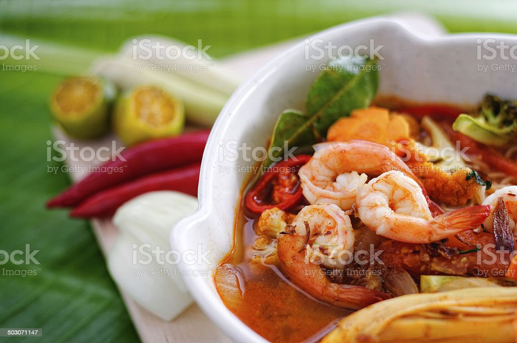 Spicy Tom Yum Kung on banana leaf. stock photo