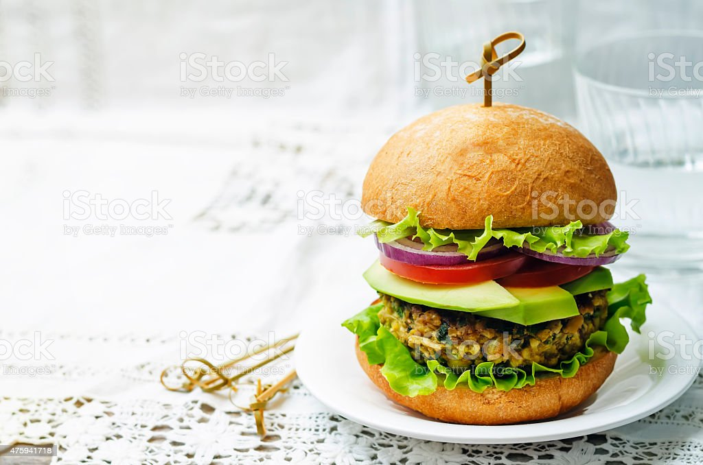 spicy vegan curry burgers with millet, chickpeas and herbs stock photo