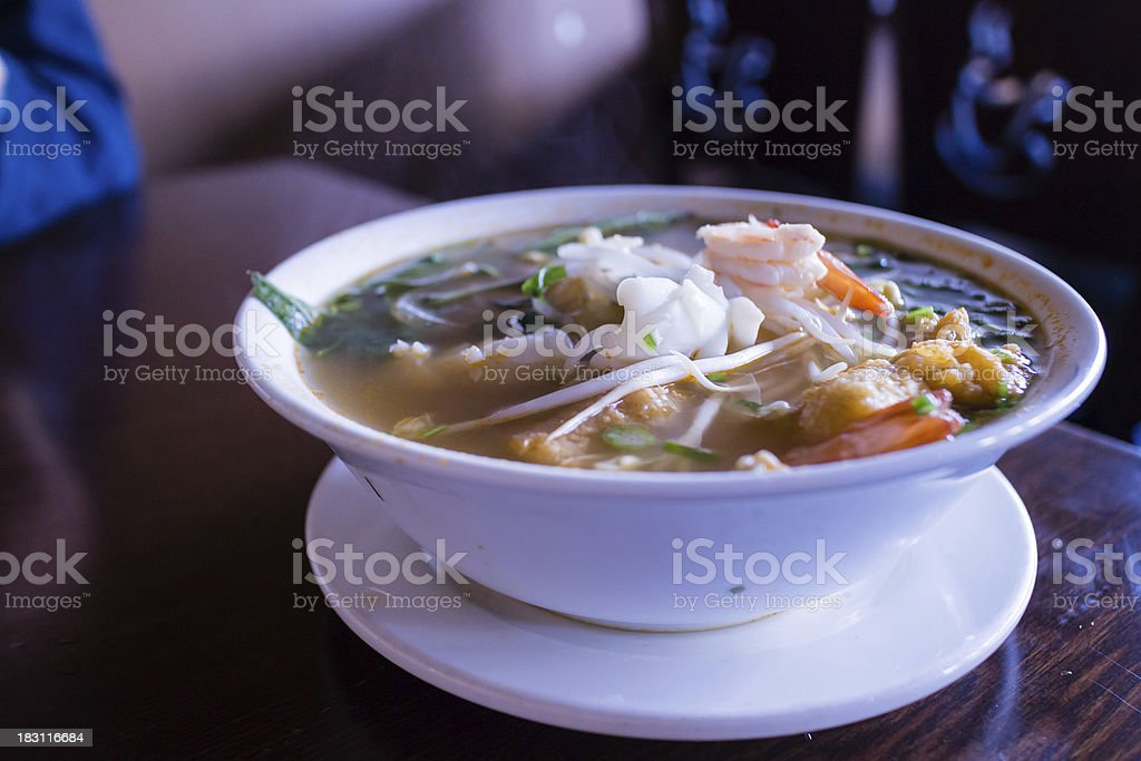spicy vietnamese seafood noodle soup royalty-free stock photo