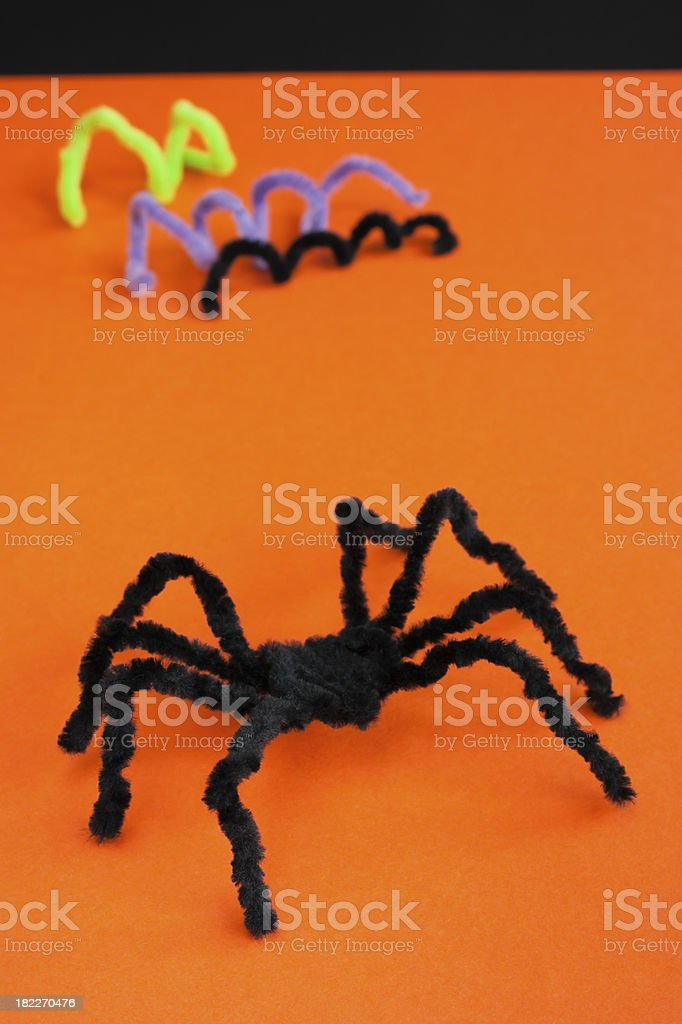 Spider for Halloween craft, black on orange. stock photo