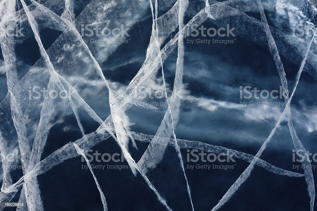 Spider web of tension cracks in thick ice layer royalty-free stock photo