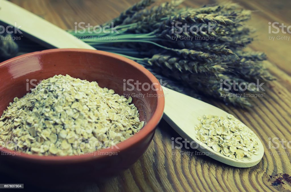 spikelets of wheat and barley in the dish stock photo