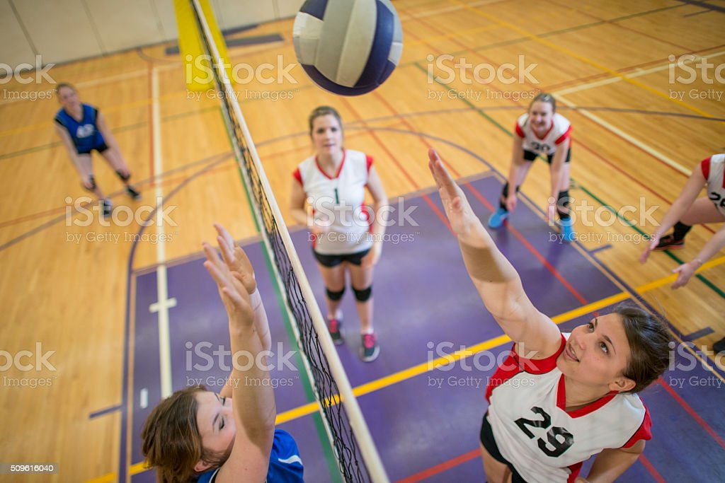 Spiking the Ball Over the Net stock photo