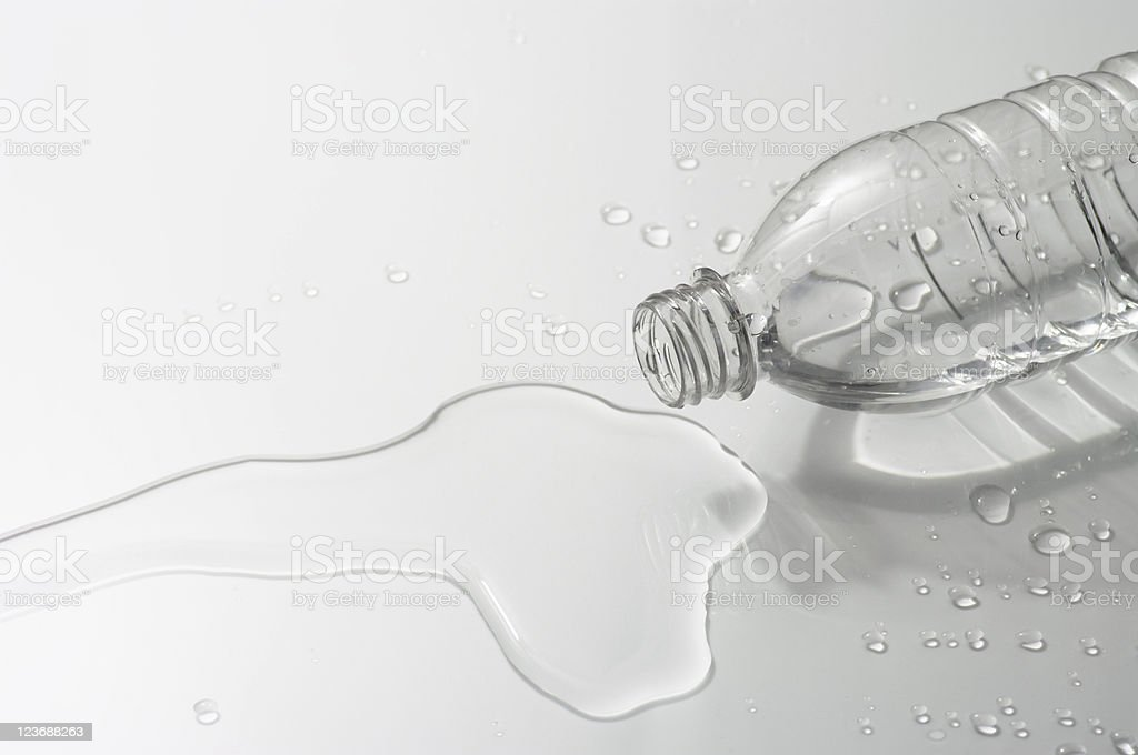 Spill a bottle stock photo