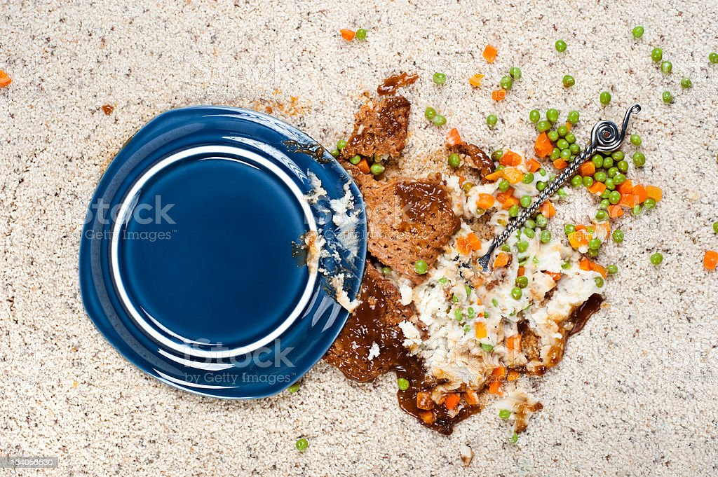 Spilled blue plate of peas, carrots, and mashed potatoes  stock photo