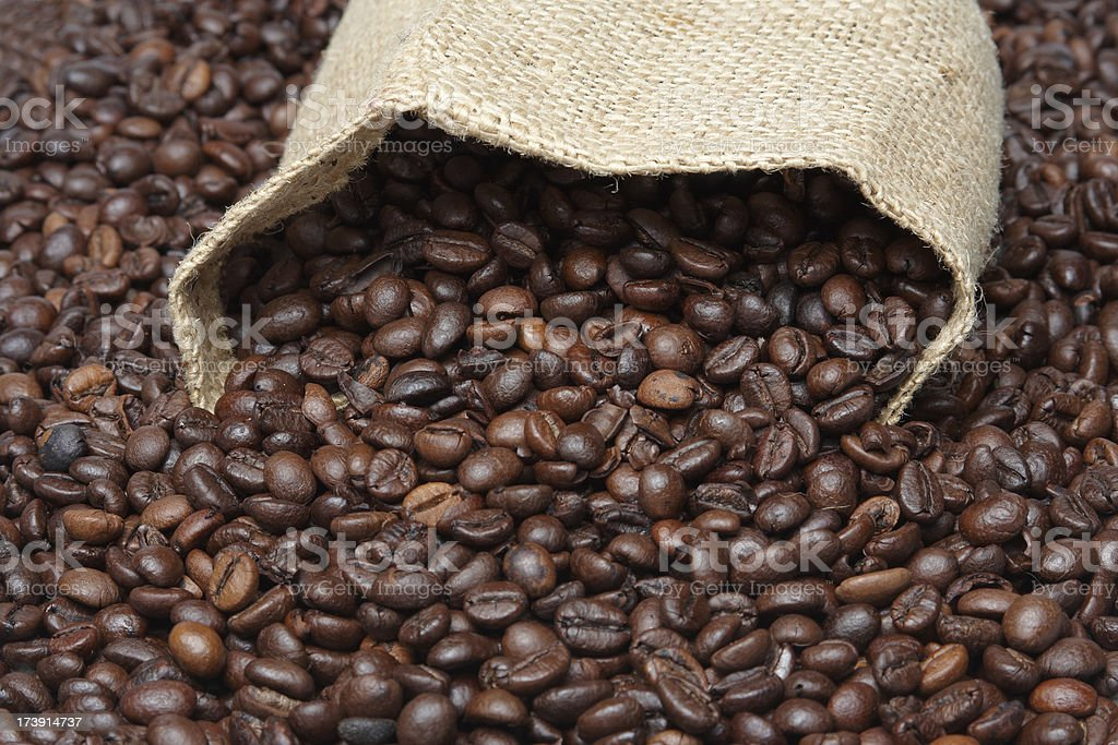 spilled coffee beans and basket royalty-free stock photo