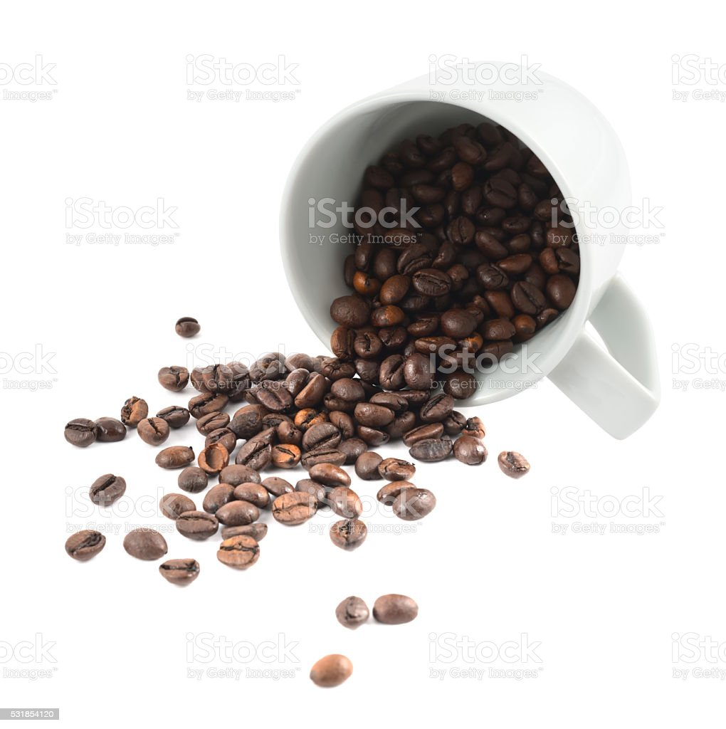 Spilled coffee beans from the cup isolated stock photo