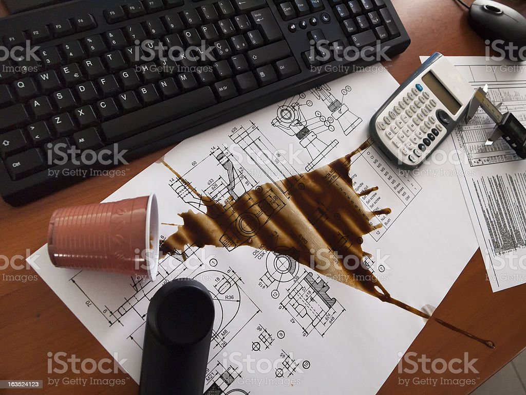 Spilled coffee on the mechanical design royalty-free stock photo