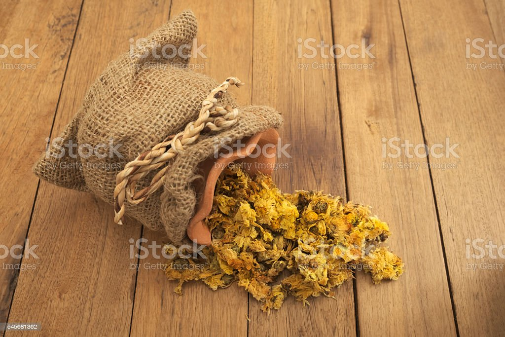 Spilled dried Crysanthemum flowers stock photo
