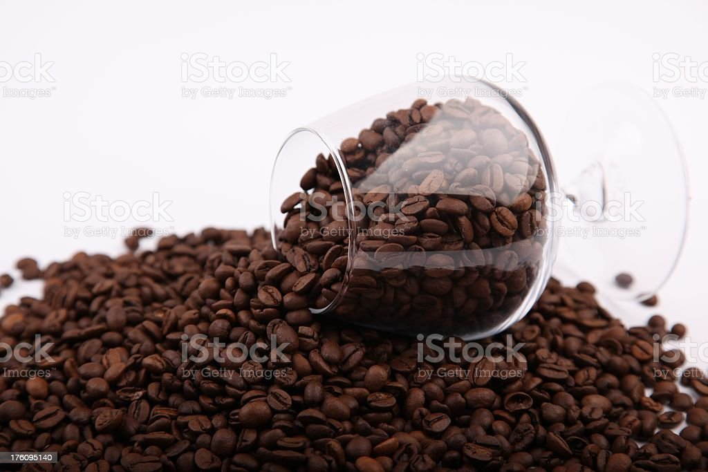 Spilled glass of coffee beans stock photo