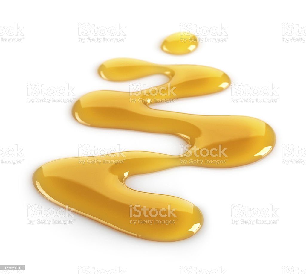 Spilled maple syrup on white background stock photo