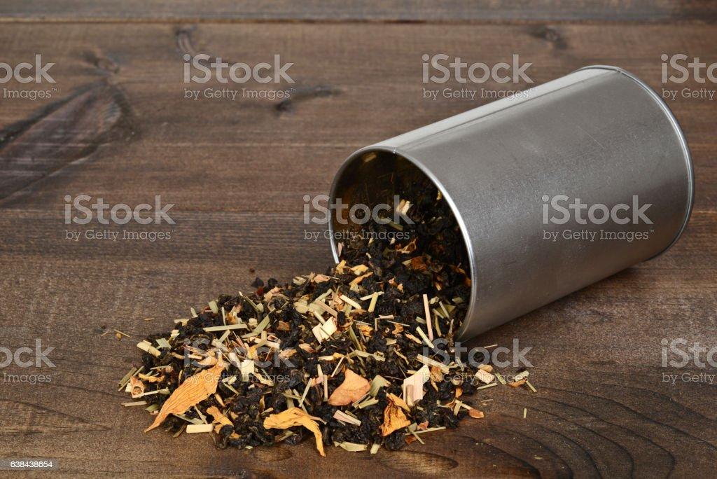 spilled organic tea with lemon grass flower petals stock photo
