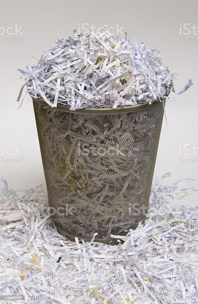 Spilled overflow waste basket shredded paper trash can photo royalty-free stock photo