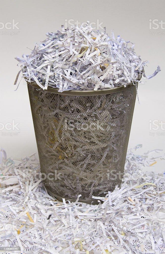 Spilled overflow waste basket shredded paper trash can photo stock photo