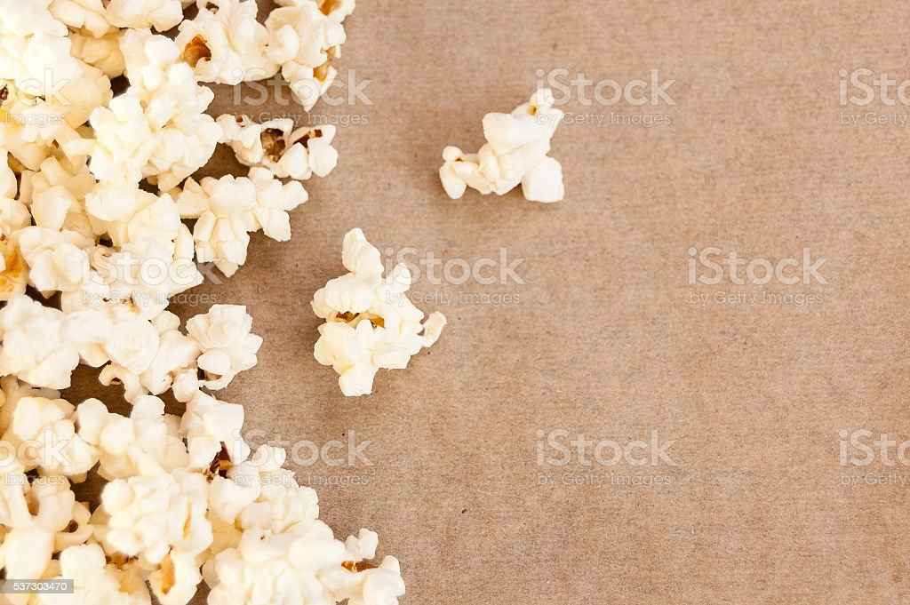 spilled popcorn on paper stock photo