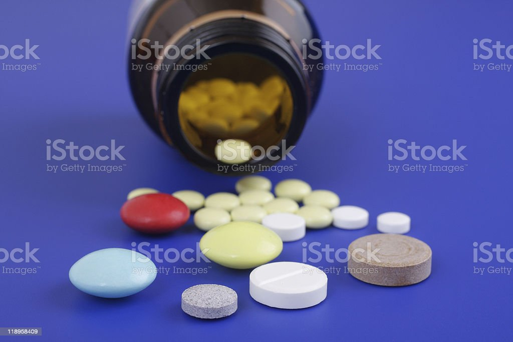 Spilled tablets and medicine bottle. royalty-free stock photo