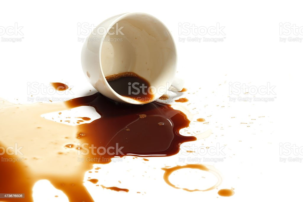 Spilled white cup of coffee on a white surface stock photo