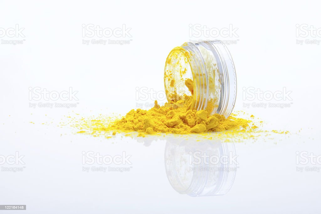 spilled yellow makeup powder stock photo