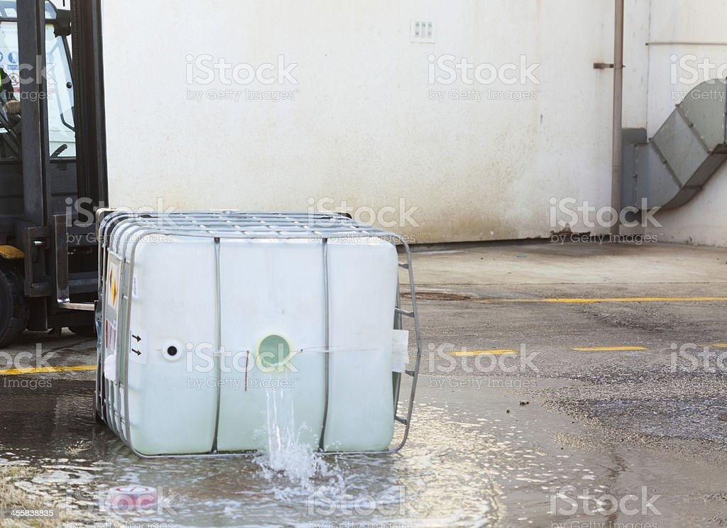 Spilling dangerous goods royalty-free stock photo