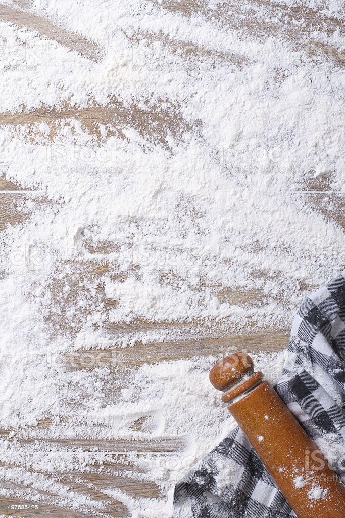 Spilling flour on the board, rolling pin and kitchen towel royalty-free stock photo