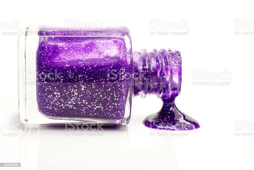 Spilling purple glitter Polish sideview stock photo