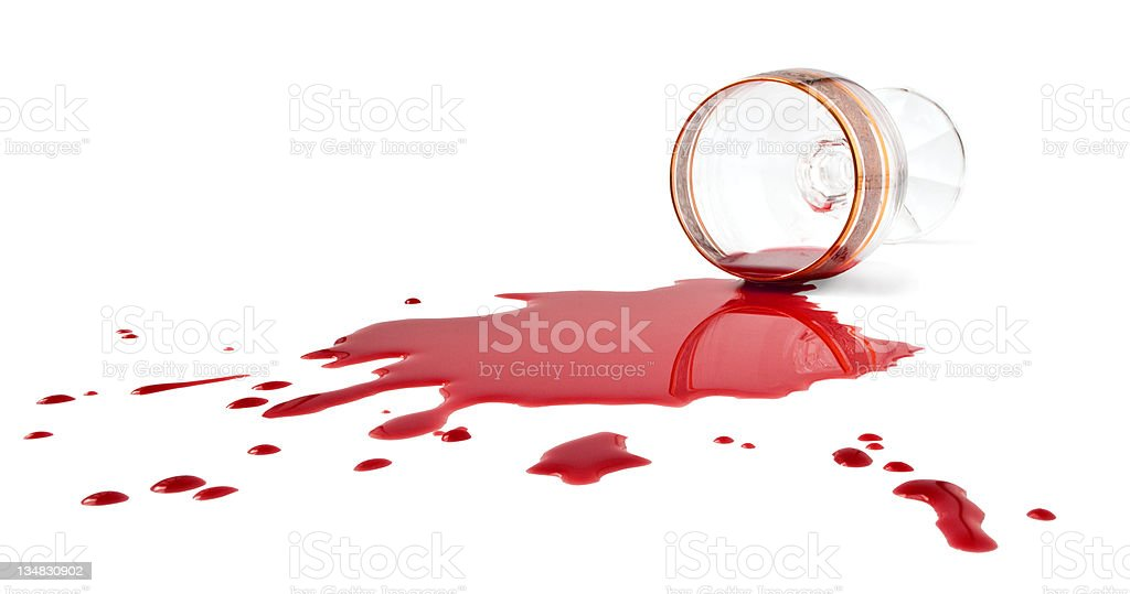 Spilling red wine from glass stock photo
