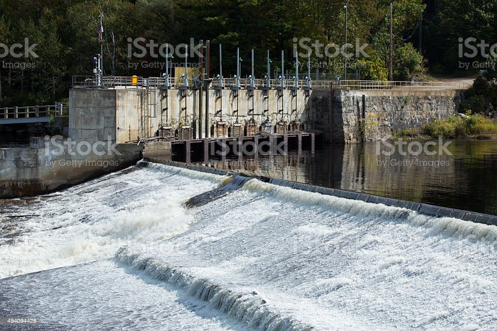 Spillway on dam of the Androscoggin River in Rumford, Maine. stock photo