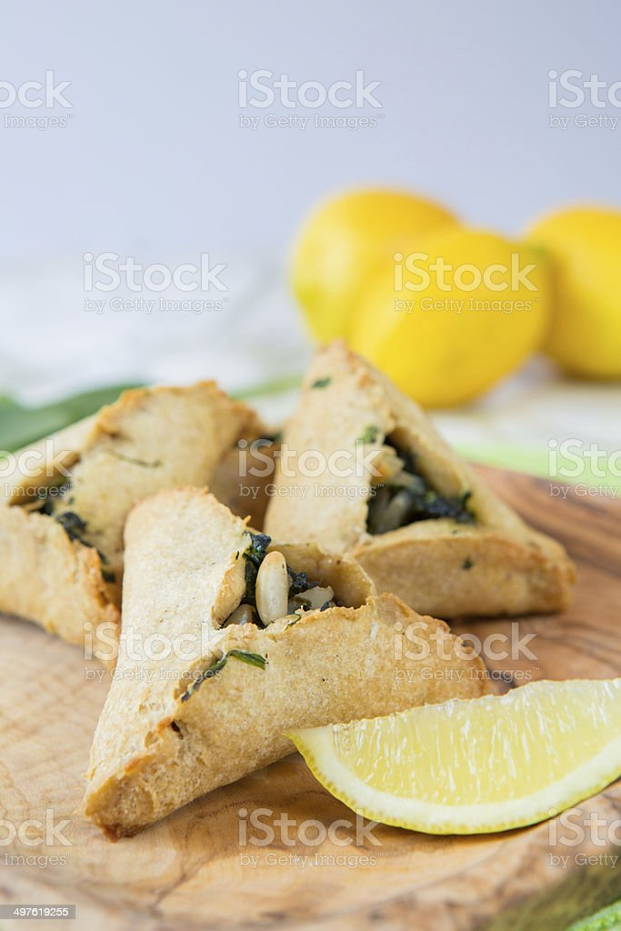 spinach and pine nuts stuffed pastry stock photo