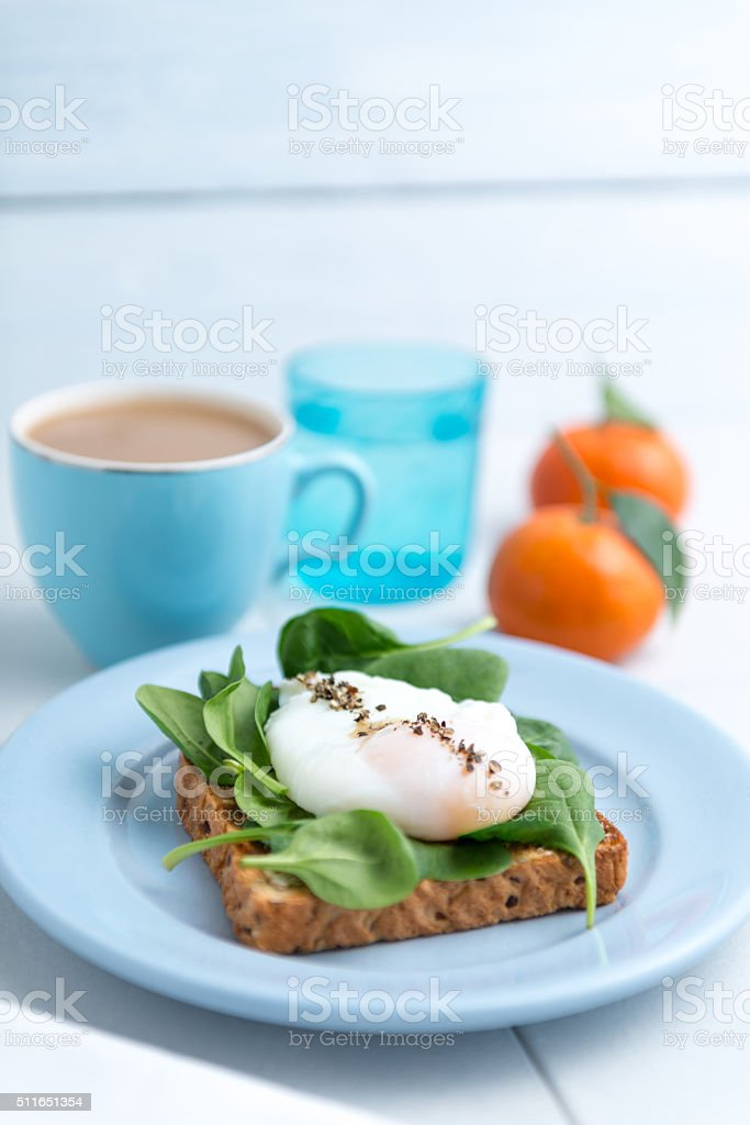 spinach and poached egg toast stock photo