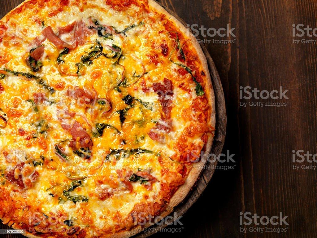 Spinach and Prosciutto Pizza stock photo