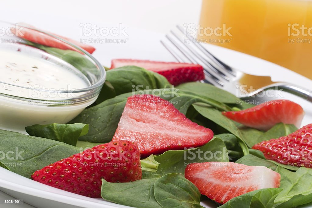 Spinach and strawberries salad royalty-free stock photo