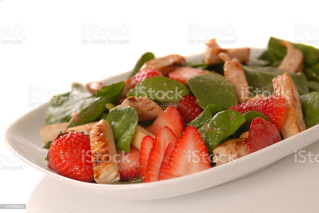 Spinach and strawberry salad stock photo