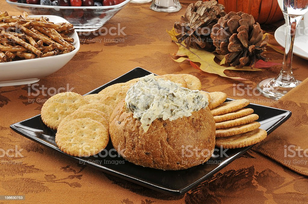 Spinach artichoke dip on a holiday table stock photo
