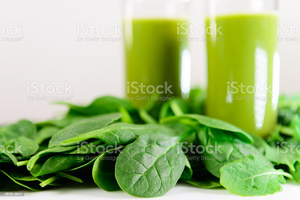 Spinach Blended into Green Smoothie stock photo